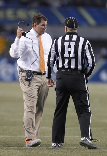 Nov 29, 2013; Pittsburgh, PA, USA; Miami Hurricanes head coach Al Golden (left) reacts as he talks to an official against the Pittsburgh Panthers during the second quarter at Heinz Field. Miami won 41-31. Mandatory Credit: Charles LeClaire-USA TODAY Sports