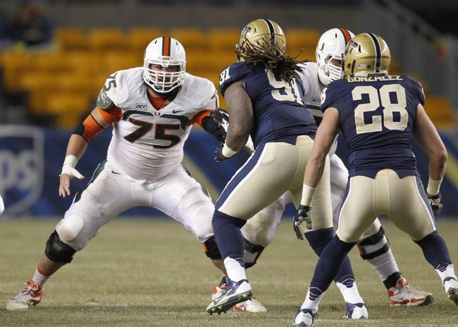 Nov 29, 2013; Pittsburgh, PA, USA; Miami Hurricanes offensive linesman Jared Wheeler (75) blocks at the line of scrimmage against the Pittsburgh Panthers during the third quarter at Heinz Field. Miami won 41-31. Mandatory Credit: Charles LeClaire-USA TODAY Sports