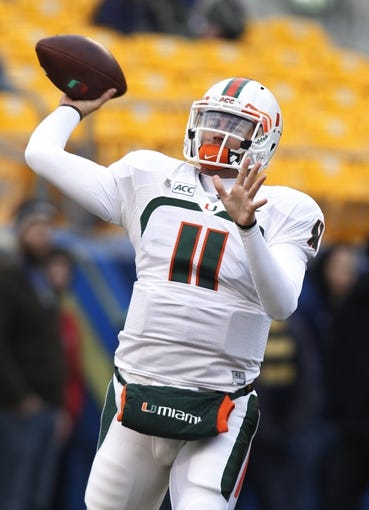 Nov 29, 2013; Pittsburgh, PA, USA; Miami Hurricanes quarterback Ryan Williams (11) throws a warm-up pass before playing the Pittsburgh Panthers at Heinz Field. Miami won 41-31. Mandatory Credit: Charles LeClaire-USA TODAY Sports