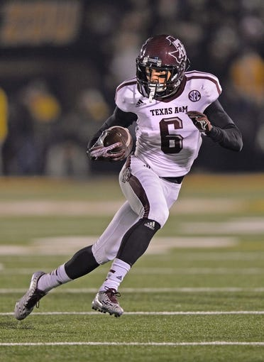 Nov 30, 2013; Columbia, MO, USA; Texas A&M Aggies wide receiver LaQuvionte Gonzalez (6) rushes up field against the Missouri Tigers during the first half at Faurot Field. Mandatory Credit: Peter G. Aiken-USA TODAY Sports