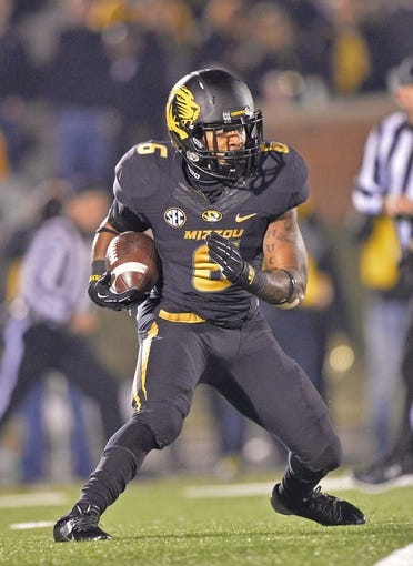 Nov 30, 2013; Columbia, MO, USA; Missouri Tigers running back Marcus Murphy (6) rushes up field against the Texas A&M Aggies during the second half at Faurot Field. Mandatory Credit: Peter G. Aiken-USA TODAY Sports