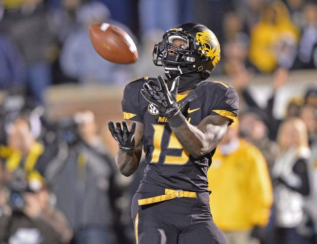 Nov 30, 2013; Columbia, MO, USA; Missouri Tigers wide receiver Dorial Green-Beckham (15) catches a touchdown pass against the Texas A&M Aggies during the first half at Faurot Field. Mandatory Credit: Peter G. Aiken-USA TODAY Sports