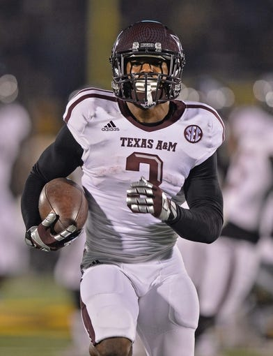 Nov 30, 2013; Columbia, MO, USA; Texas A&M Aggies running back Trey Williams (3) warms up before a game against the Missouri Tigers at Faurot Field. Mandatory Credit: Peter G. Aiken-USA TODAY Sports