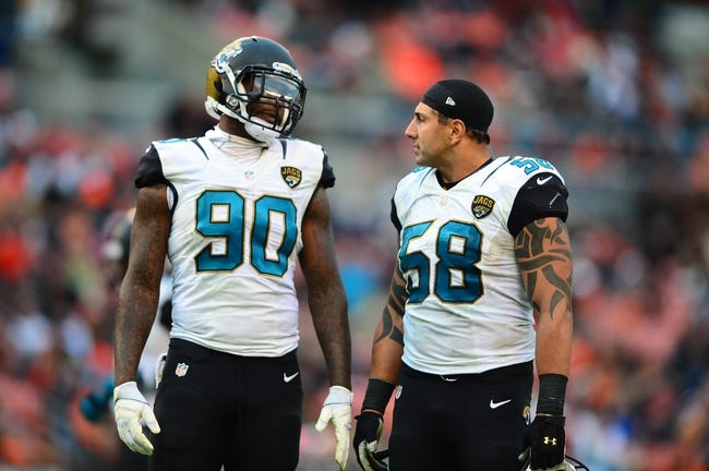 Dec 1, 2013; Cleveland, OH, USA; Jacksonville Jaguars defensive end Andre Branch (90) and defensive end Jason Babin (58) against the Cleveland Browns at FirstEnergy Stadium. Mandatory Credit: Andrew Weber-USA TODAY Sports