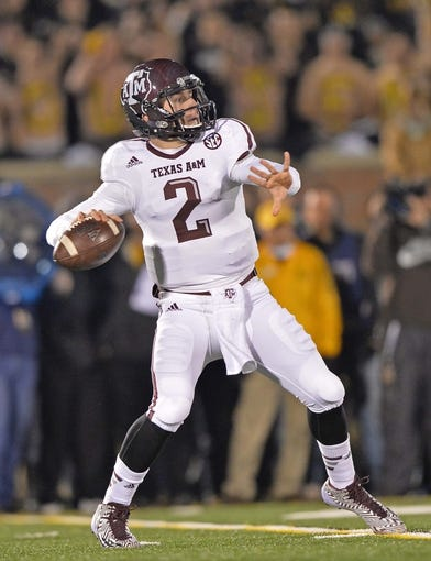 Nov 30, 2013; Columbia, MO, USA; Texas A&M Aggies quarterback Johnny Manziel (2) drops back to pass against the Missouri Tigers during the first half at Faurot Field. Mandatory Credit: Peter G. Aiken-USA TODAY Sports
