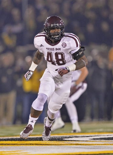 Nov 30, 2013; Columbia, MO, USA; Texas A&M Aggies linebacker Darian Claiborne (48) gets set on defense against the Missouri Tigers during the second half at Faurot Field. Mandatory Credit: Peter G. Aiken-USA TODAY Sports