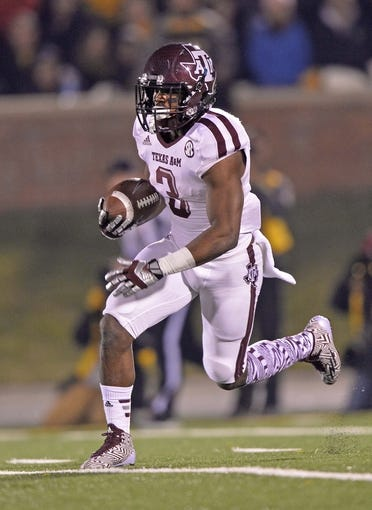 Nov 30, 2013; Columbia, MO, USA; Texas A&M Aggies running back Trey Williams (3) returns a kick-off against the Missouri Tigers during the first half at Faurot Field. Mandatory Credit: Peter G. Aiken-USA TODAY Sports