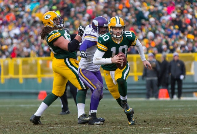 Nov 24, 2013; Green Bay, WI, USA; Green Bay Packers quarterback Matt Flynn (10) runs with the football during the game against the Minnesota Vikings at Lambeau Field.  The Vikings and Packers tied 26-26.  Mandatory Credit: Jeff Hanisch-USA TODAY Sports