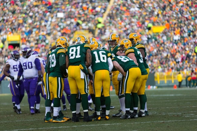 Nov 24, 2013; Green Bay, WI, USA; The Green Bay Packers offense huddles around quarterback Scott Tolzien (16) during the game against the Minnesota Vikings at Lambeau Field.  The Vikings and Packers tied 26-26.  Mandatory Credit: Jeff Hanisch-USA TODAY Sports
