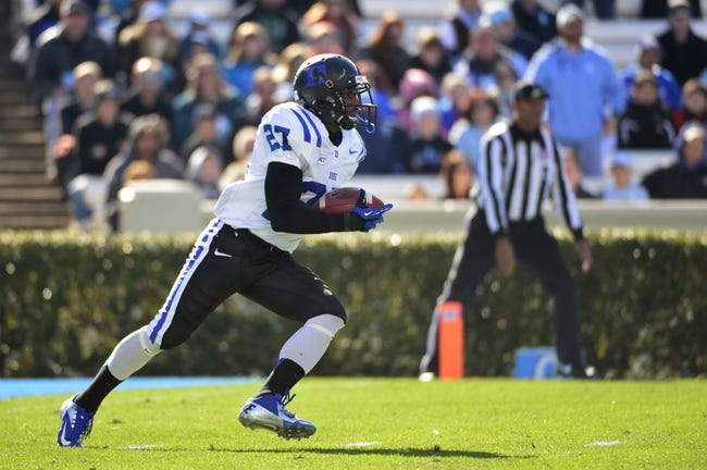 Nov 30, 2013; Chapel Hill, NC, USA;  Duke Blue Devils cornerback DeVon Edwards (27) runs in the first quarter at Kenan Memorial Stadium. Mandatory Credit: Bob Donnan-USA TODAY Sports