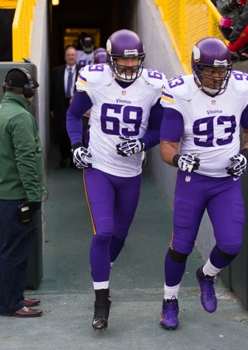 Nov 24, 2013; Green Bay, WI, USA; Minnesota Vikings defensive end Jared Allen (69) runs onto the field prior to the game against the Green Bay Packers at Lambeau Field.  The Vikings and Packers tied 26-26.  Mandatory Credit: Jeff Hanisch-USA TODAY Sports