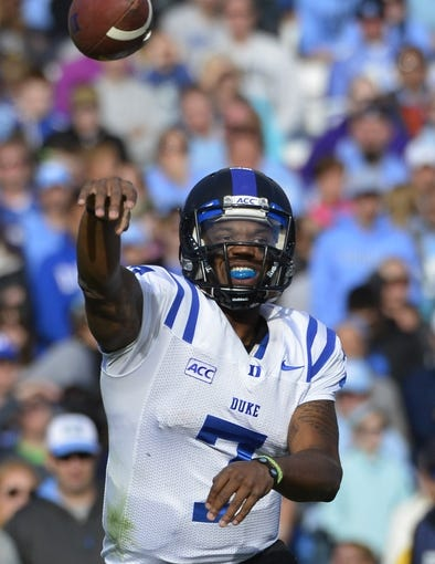 Nov 30, 2013; Chapel Hill, NC, USA; Duke Blue Devils quarterback Anthony Boone (7) passes in the third quarter. The Blue Devils defeated the Tar Heels 27-25 at Kenan Memorial Stadium. Mandatory Credit: Bob Donnan-USA TODAY Sports