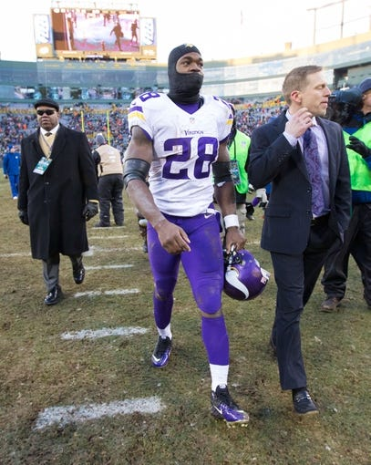 Nov 24, 2013; Green Bay, WI, USA; Minnesota Vikings running back Adrian Peterson (28) following the game against the Green Bay Packers at Lambeau Field.  The Vikings and Packers tied 26-26.  Mandatory Credit: Jeff Hanisch-USA TODAY Sports