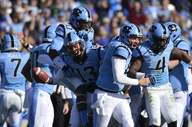 Nov 30, 2013; Chapel Hill, NC, USA; North Carolina Tar Heels safety Brandon Ellerbe (20) and wide receiver Mack Hollins (13) and long snapper Conor Fry (61) and cornerback Jabari Price (4) react after Hollins fumble recovery in the second quarter at Kenan Memorial Stadium. Mandatory Credit: Bob Donnan-USA TODAY Sports