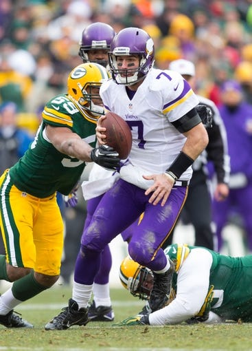 Nov 24, 2013; Green Bay, WI, USA; Minnesota Vikings quarterback Christian Ponder (7) during the game against the Green Bay Packers at Lambeau Field.  The Vikings and Packers tied 26-26.  Mandatory Credit: Jeff Hanisch-USA TODAY Sports
