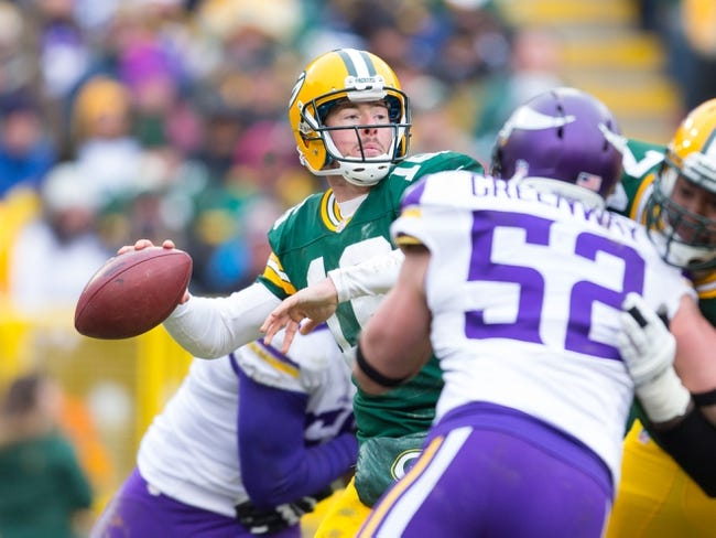 Nov 24, 2013; Green Bay, WI, USA; Green Bay Packers quarterback Scott Tolzien (16) during the game against the Minnesota Vikings at Lambeau Field.  The Vikings and Packers tied 26-26.  Mandatory Credit: Jeff Hanisch-USA TODAY Sports
