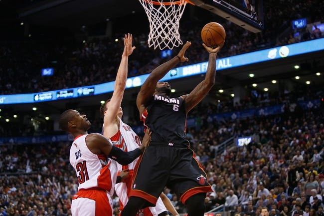 Nov 29, 2013; Toronto, Ontario, CAN; Miami Heat forward LeBron James (6) goes up for a lay up as Toronto Raptors guard Terrence Ross (31) and forward Tyler Hansbrough (50) defend at the Air Canada Centre. Miami defeated Toronto 90-83. Mandatory Credit: John E. Sokolowski-USA TODAY Sports