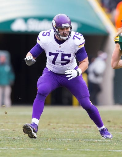 Nov 24, 2013; Green Bay, WI, USA; Minnesota Vikings offensive tackle Matt Kalil (75) during the game against the Green Bay Packers at Lambeau Field.  The Vikings and Packers tied 26-26.  Mandatory Credit: Jeff Hanisch-USA TODAY Sports
