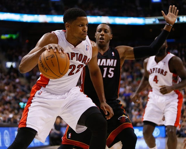 Nov 29, 2013; Toronto, Ontario, CAN; Toronto Raptors forward Rudy Gay (22) carries the ball past Miami Heat guard Mario Chalmers (15) at the Air Canada Centre. Miami defeated Toronto 90-83. Mandatory Credit: John E. Sokolowski-USA TODAY Sports