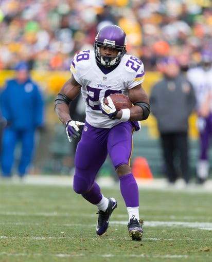 Nov 24, 2013; Green Bay, WI, USA; Minnesota Vikings running back Adrian Peterson (28) during the game against the Green Bay Packers at Lambeau Field.  The Vikings and Packers tied 26-26.  Mandatory Credit: Jeff Hanisch-USA TODAY Sports