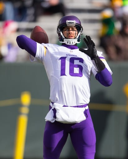 Nov 24, 2013; Green Bay, WI, USA; Minnesota Vikings quarterback Matt Cassel (16) during warmups prior to the game against the Green Bay Packers at Lambeau Field.  The Vikings and Packers tied 26-26.  Mandatory Credit: Jeff Hanisch-USA TODAY Sports
