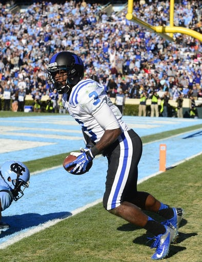 Nov 30, 2013; Chapel Hill, NC, USA;  Duke Blue Devils wide receiver Jamison Crowder (3) reacts after scoring a touchdown in the third quarter. The Duke Blue Devils defeated the North Carolina Tar Heels 27-25 at Kenan Memorial Stadium. Mandatory Credit: Bob Donnan-USA TODAY Sports