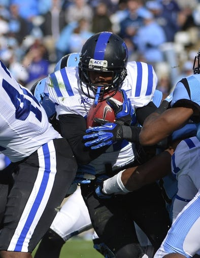 Nov 30, 2013; Chapel Hill, NC, USA;  Duke Blue Devils cornerback DeVon Edwards (27) runs in the first quarter at Kenan Memorial Stadium. Mandatory Credit: Bob Donnan-USA TODAY Sports