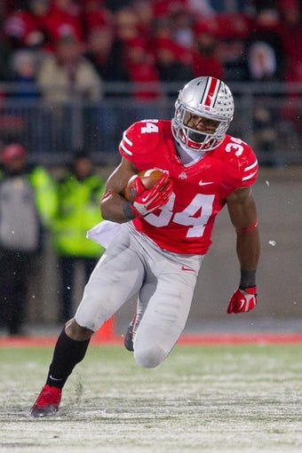 Nov 23, 2013; Columbus, OH, USA;  Ohio State Buckeyes running back Carlos Hyde (34) runs the ball in the third quarter of the game against the Indiana Hoosiers at Ohio Stadium. Ohio State Buckeyes beat Indiana Hoosiers 42-14. Mandatory Credit: Trevor Ruszkowksi-USA TODAY Sports