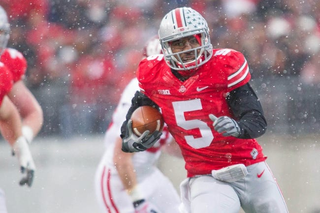 Nov 23, 2013; Columbus, OH, USA; Ohio State Buckeyes quarterback Braxton Miller (5) runs the ball in the first quarter of the game against the Indiana Hoosiers at Ohio Stadium. Ohio State Buckeyes beat Indiana Hoosiers 42-14. Mandatory Credit: Trevor Ruszkowksi-USA TODAY Sports