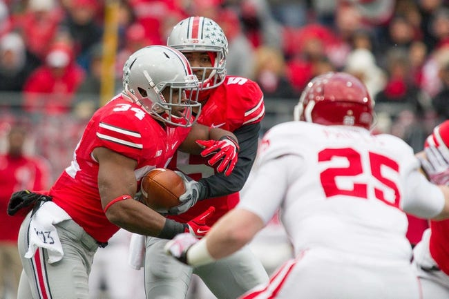 Nov 23, 2013; Columbus, OH, USA;  Ohio State Buckeyes quarterback Braxton Miller (5) hands the ball off to running back Carlos Hyde (34) in the first quarter of the game against the Indiana Hoosiers at Ohio Stadium. Ohio State Buckeyes beat Indiana Hoosiers 42-14. Mandatory Credit: Trevor Ruszkowksi-USA TODAY Sports