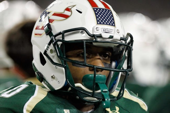 Nov 16, 2013; Tampa, FL, USA; South Florida Bulls running back Marcus Shaw (20) against the Memphis Tigers during the first quarter at Raymond James Stadium. Mandatory Credit: Kim Klement-USA TODAY Sports