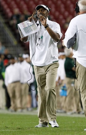 Nov 16, 2013; Tampa, FL, USA; South Florida Bulls head coach Willie Taggart calls a play against the Memphis Tigers during the first quarter at Raymond James Stadium. Mandatory Credit: Kim Klement-USA TODAY Sports