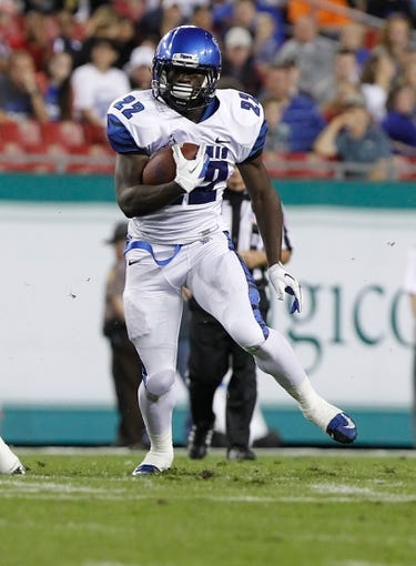 Nov 16, 2013; Tampa, FL, USA; Memphis Tigers running back Doroland Dorceus (22) runs with the ball against the South Florida Bulls during the first quarter at Raymond James Stadium. Mandatory Credit: Kim Klement-USA TODAY Sports