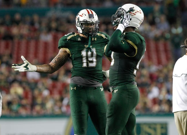 Nov 16, 2013; Tampa, FL, USA; South Florida Bulls defensive lineman Aaron Lynch (19) talks with defensive lineman Tevin Mims (99) against the Memphis Tigers during the first quarter at Raymond James Stadium. Mandatory Credit: Kim Klement-USA TODAY Sports