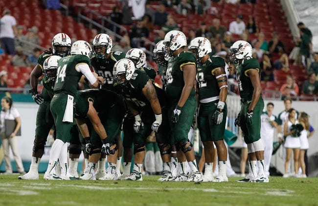 Nov 16, 2013; Tampa, FL, USA; South Florida Bulls quarterback Mike White (14) huddles up with the offense against the Memphis Tigers during the second half at Raymond James Stadium. Memphis Tigers defeated the South Florida Bulls 23-10. Mandatory Credit: Kim Klement-USA TODAY Sports