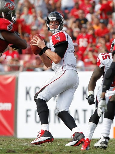 Nov 17, 2013; Tampa, FL, USA; Atlanta Falcons quarterback Matt Ryan (2) drops back against the Tampa Bay Buccaneers during the second half at Raymond James Stadium. Tampa Bay Buccaneers defeated the Atlanta Falcons 41-28. Mandatory Credit: Kim Klement-USA TODAY Sports