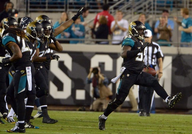 Dec 5, 2013; Jacksonville, FL, USA; Jacksonville Jaguars linebacker Geno Hayes (55) celebrates after intercepting a pass in the fourth quarter against the Houston Texans at EverBank Field. The Jaguars defeated the Texans 27-20.  Mandatory Credit: Kirby Lee-USA TODAY Sports