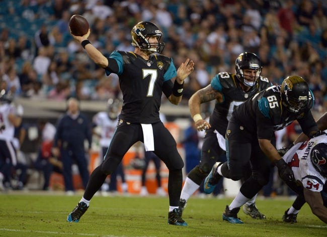Dec 5, 2013; Jacksonville, FL, USA; Jacksonville Jaguars quarterback Chad Henne (7) throws a pass against the Houston Texans at EverBank Field. The Jaguars defeated the Texans 27-20.  Mandatory Credit: Kirby Lee-USA TODAY Sports