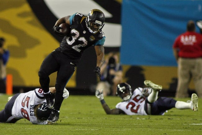 Dec 5, 2013; Jacksonville, FL, USA; Jacksonville Jaguars running back Maurice Jones-Drew (32) gets past a tackle attempt by Houston Texans linebacker Brooks Reed (58), but injures himself in the fourth quarter at EverBank Field. The Jacksonville Jaguars best the Houston Texans 27-20. Mandatory Credit: Phil Sears-USA TODAY Sports