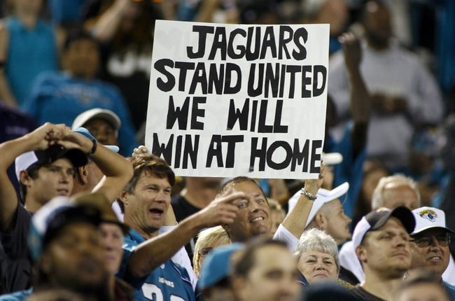 Dec 5, 2013; Jacksonville, FL, USA; Jacksonville Jaguars fans hold a sign in the fourth quarter against the Houston Texans at EverBank Field. The Jacksonville Jaguars best the Houston Texans 27-20. Mandatory Credit: Phil Sears-USA TODAY Sports