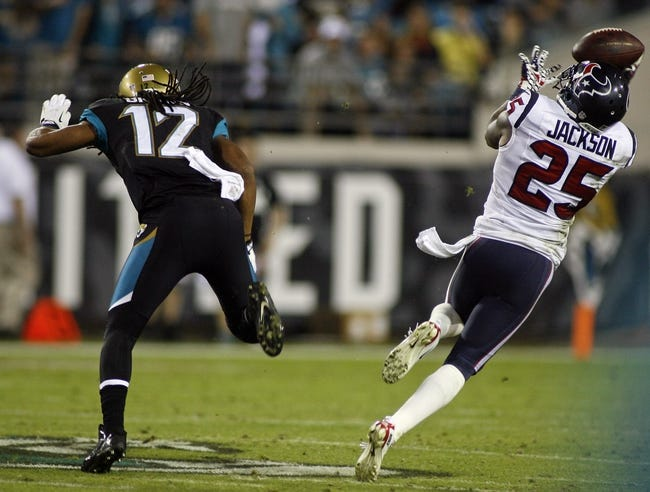 Dec 5, 2013; Jacksonville, FL, USA; Houston Texans defensive back Kareem Jackson (25) nearly intercepts a pass after pushing off of Jacksonville Jaguars wide receiver Mike Brown (12) in the fourth quarter at EverBank Field. Brown was penalized for pass interference. The Jacksonville Jaguars best the Houston Texans 27-20. Mandatory Credit: Phil Sears-USA TODAY Sports
