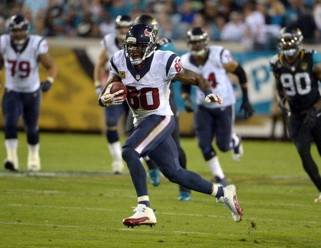 Dec 5, 2013; Jacksonville, FL, USA; Houston Texans receiver Andre Johnson (80) carries the ball against the Jacksonville Jaguars at EverBank Field. The Jaguars defeated the Texans 27-20.  Mandatory Credit: Kirby Lee-USA TODAY Sports