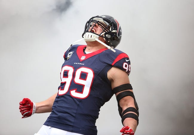 Dec 1, 2013; Houston, TX, USA; Houston Texans defensive end J.J. Watt (99) yells as he is introduced prior to the game against the New England Patriots at Reliant Stadium. Mandatory Credit: Matthew Emmons-USA TODAY Sports