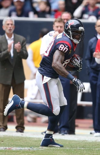 Dec 1, 2013; Houston, TX, USA; Houston Texans receiver Andre Johnson (80) runs after a reception against the New England Patriots at Reliant Stadium. Mandatory Credit: Matthew Emmons-USA TODAY Sports