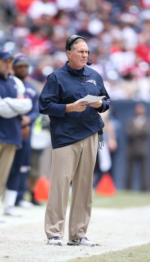Dec 1, 2013; Houston, TX, USA; New England Patriots head coach Bill Belichick on the sidelines against the Houston Texans at Reliant Stadium. Mandatory Credit: Matthew Emmons-USA TODAY Sports