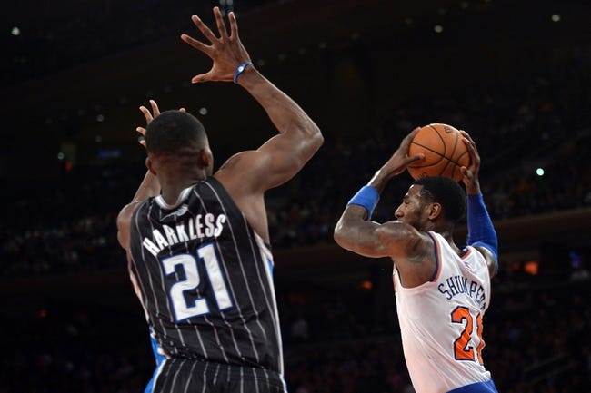 Dec 6, 2013; New York, NY, USA; Orlando Magic small forward Maurice Harkless (21) guards New York Knicks shooting guard Iman Shumpert (21) during the second half at Madison Square Garden. The Knicks won the game 121-83. Mandatory Credit: Joe Camporeale-USA TODAY Sports
