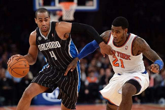 Dec 6, 2013; New York, NY, USA; New York Knicks shooting guard Iman Shumpert (21) guards Orlando Magic shooting guard Arron Afflalo (4) during the first half at Madison Square Garden. The Knicks won the game 121-83. Mandatory Credit: Joe Camporeale-USA TODAY Sports