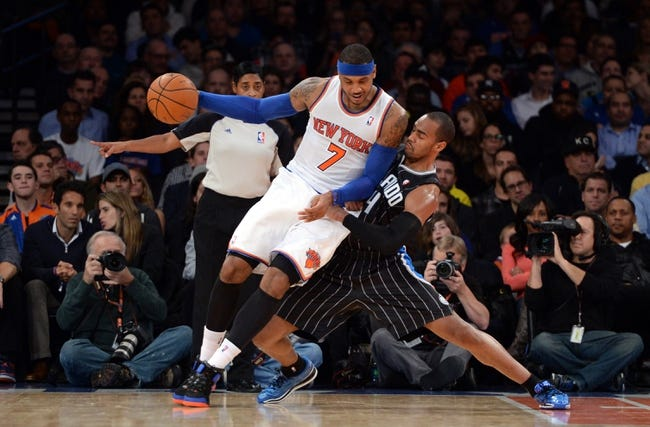 Dec 6, 2013; New York, NY, USA; Orlando Magic shooting guard Arron Afflalo (4) guards New York Knicks small forward Carmelo Anthony (7) during the first half at Madison Square Garden. The Knicks won the game 121-83. Mandatory Credit: Joe Camporeale-USA TODAY Sports