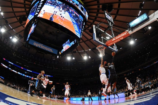 Dec 6, 2013; New York, NY, USA; Orlando Magic power forward Glen Davis (11) puts up a shot over New York Knicks power forward Kenyon Martin (3) during the first half at Madison Square Garden. The Knicks won the game 121-83. Mandatory Credit: Joe Camporeale-USA TODAY Sports