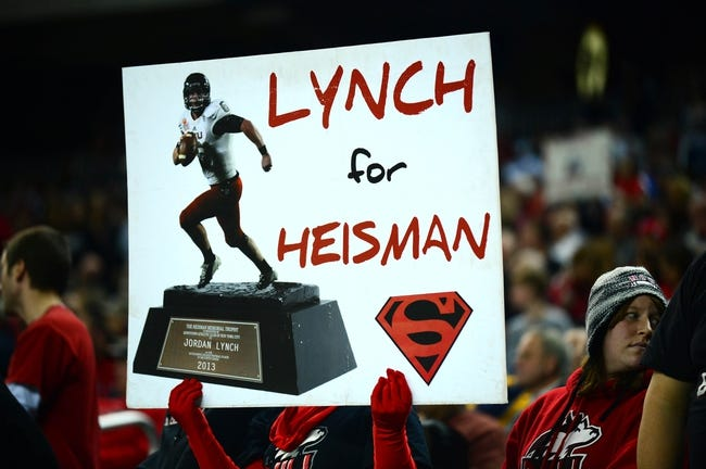 Dec 6, 2013; Detroit, MI, USA; Northern Illinois Huskies fan holds a sign showing support for Northern Illinois Huskies quarterback Jordan Lynch (not pictured) during the fourth quarter against the Bowling Green Falcons at Ford Field. Mandatory Credit: Andrew Weber-USA TODAY Sports